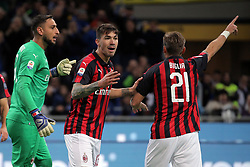 October 21, 2018 - Milan, Milan, Italy - Lucas Biglia #21 of AC Milan and Alessio Romagnoli #13 of AC Milan during the serie A match between FC Internazionale and AC Milan at Stadio Giuseppe Meazza on October 21, 2018 in Milan, Italy. (Credit Image: © Giuseppe Cottini/NurPhoto via ZUMA Press)