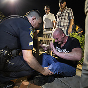 CHARLOTTESVILLE,VA-AUG11:A white nationalist is helped by police after being overcome with tear gas after hundreds of white nationalists and white supremacists carrying torches marched in a parade through the University of Virginia campus. Beginning a little after 9:30 p.m., the march lasted 15 to 20 minutes before ending in skirmishing when the marchers were met by a small group of counterprotesters at the base of a statue of Thomas Jefferson, the university's founder. (Photo by Evelyn Hockstein/For The Washington Post)