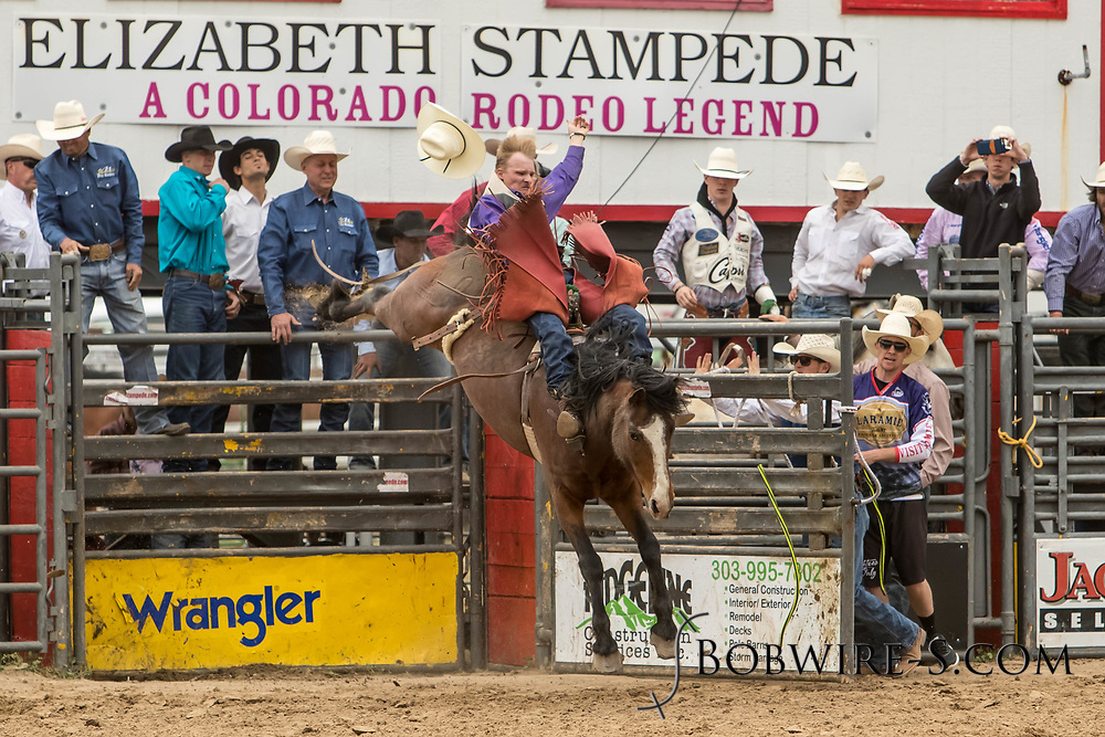 Bareback rider Logan Corbett rides Summit Pro Rodeo's Major Party during the third performance of the Elizabeth Stampede on Sunday, June 3, 2018.