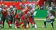 Tampa Bay Buccaneers running back Peyton Barber (25) carries the ball against the Carolina Panthers during the second quarter of an NFL International Series game at Tottenham Hotspur Stadium, Sunday, Oct. 13, 2019, in London.  The Panthers defeated the Buccaneers 37-26. (Gareth Williams/Image of Sport)