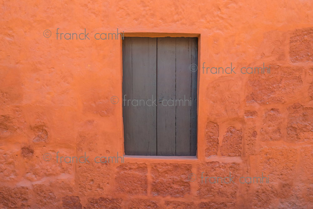 wooden window in Santa Catalina monastery in the peruvian Andes at Arequipa Peru