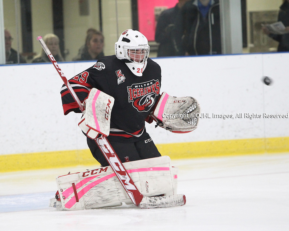 MILTON, ON - Oct 23, 2015 : Ontario Junior Hockey League game action between Kingston and Milton. Anthony Coletta #29 of the Milton Ice Hawks makes the save during the pre-game warmup.<br /> (Photo by Tim Bates / OJHL Images)