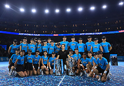 Andy Murray poses with his trophies and the ball team during day eight of the Barclays ATP World Tour Finals at The O2, London.