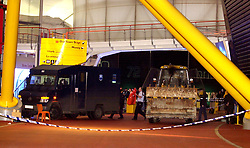 "An armoured van being loaded by police, after a foiled raid on a diamond display in The Millennium Dome at Greenwich.  Six people were arrested, including four in the Money zone vault, and two by the River Thames, where the robbers had a powerboat waiting to escape from the scene.   *... The raiders used a bulldozer to break into the Dome, and had it been successful, it would have been the world's largest ever robbery.    * 08/11/2001: Police foiled the ""robbery"" of the jewels when they caught raiders red handed as they smashed their way in using a mechanical digger, an Old Bailey court heard, at the opening of the trial of six men accused of plotting to rob the De Beers Millennium Diamond Exhibition with others unknown."