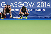 Dean Couzins and Simon Child of New Zealand dejected after losing the bronze medal match between New Zealand and England. Glasgow 2014 Commonwealth Games. Hockey, Bronze Medal Match, Black Sticks Men v England, Glasgow Green Hockey Centre, Glasgow, Scotland. Sunday 3 August 2014. Photo: Anthony Au-Yeung / photosport.co.nz