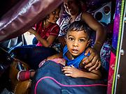 08 OCTOBER 2017 - GAMPAHA, WESTERN PROVINCE, SRI LANKA: A child in a tuk-tuk (three wheeled taxi) in Gampaha, a community north of Colombo.    PHOTO BY JACK KURTZ