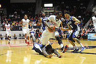 """Ole Miss Rebels guard Stefan Moody (42) is fouled by a diving TCU Horned Frogs forward Chris Washburn (33) as TCU Horned Frogs guard Kyan Anderson (5) also defends at the C.M. """"Tad"""" Smith Coliseum in Oxford, Miss. on Thursday, December 4, 2014. (AP Photo/Oxford Eagle, Bruce Newman)"""