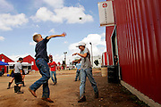Colton Draper, 11 of Melrose, leaves the ground during a game of wall ball with fellow fair participants from Melrose at the Curry County Fair on Wednesday, August 16, 2006. The group started playing the game to help pass the time between animal shows.