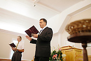 Pastor John Melvin sings with his congregation, including Clyde Sprague (left), during the Sunday service at Camp Creek Primitive Baptist Church in Lilburn, Georgia September 30, 2012...The church, which was formed in 1823 is the oldest active church in Gwinnett County, Georgia and currently has around 70 members. Pastor John Melvin, who is also the Assistant District Attorney in Deklab County, has been pastor of the church for fourteen years.