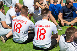 Two fans have Its Coming Home 2018 printed on their shirts - Ryan Hiscott/JMP - 05/07/2018 - FOOTBALL - Ashton Gate - Bristol, England - Sweden v England, World Cup Quarter Final, World Cup Village at Ashton Gate