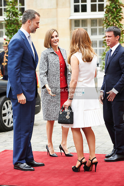 King Felipe VI of Spain and Queen Letizia of Spain attend a Lunch with Prime Minister of France Manuel Valls and wife, Anne Gravoin at Hotel Matignon on June 3, 2015 in Paris