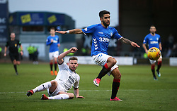Dundee's Andy Boyle (left) and Rangers' Daniel Candeias battle for the ball during the Scottish Premiership match at Dens Park, Dundee.