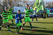 Forest Green Rovers Christian Doidge(9) with matochday mascot during the EFL Sky Bet League 2 match between Forest Green Rovers and Crawley Town at the New Lawn, Forest Green, United Kingdom on 24 February 2018. Picture by Shane Healey.