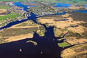 Nederland, Friesland, Gemeente Tietjerksteradeel, 01-05-2013; Nationaal Park De Alde Feanen (De Oude Venen), Eernewoude. Boven in beeld Camping en Bungalowpark It Wiid.<br /> Laagveengebied, cultuurlandschap gedeeltelijk ontstaan door vervening. Laagveenmoeras met meren, veenplassen, petgaten<br /> Natura 2000 gebied, in beheer bij It Fryske Gea<br /> Camping and recreation park in nature reserve and National Park De Alde Feanen (Old Peat Area), Eernewoude.<br /> Culture landscape, partly resulting from peat digging. Northern Netherlands.<br /> luchtfoto (toeslag op standard tarieven)<br /> aerial photo (additional fee required)<br /> copyright foto/photo Siebe Swart