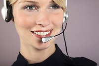 Businesswoman wearing headset close-up portrait