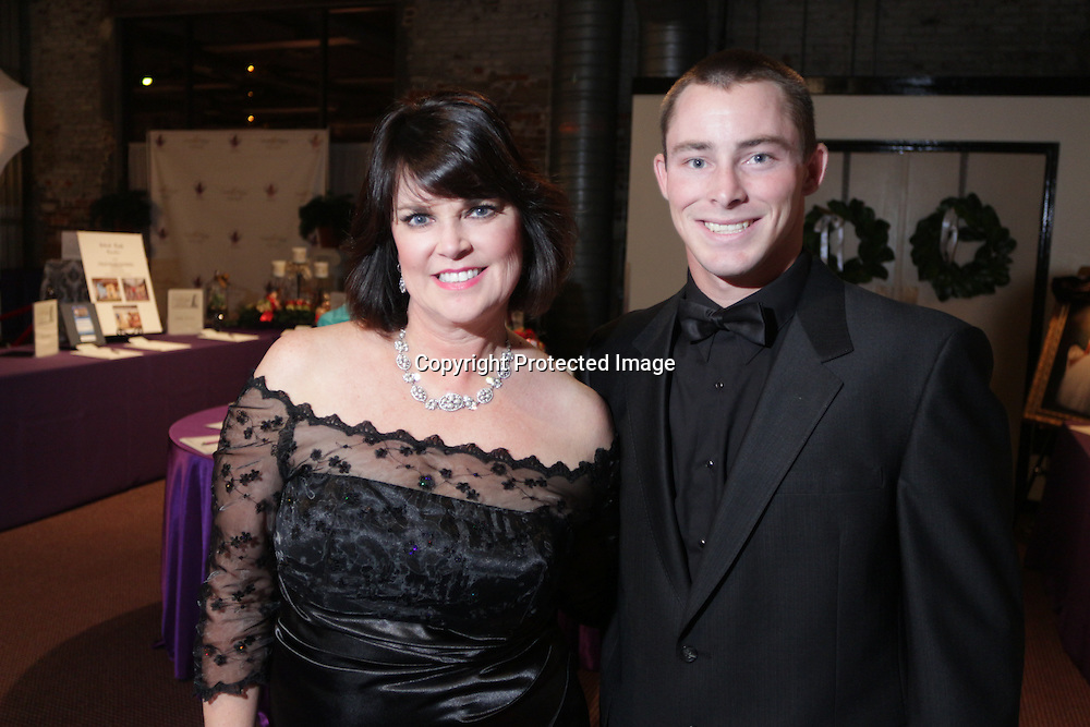 Sharon Evans, left, and Taylor Webster pose for a picture during the Diamonds and Champagne Hope Ball Saturday November 22, 2014 at the Coastline Convention Center in Wilmington, N.C. (Jason A. Frizzelle)