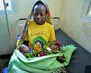 A new mother with twins in the neonatal ward in Nayagatare, Rwanda....
