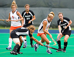 Virginia Cavaliers forward Kaitlyn Hiltz (7) sends the ball over the stick of Providence Friars defender Ashley Mulkey (4).  The Virginia Cavaliers field hockey team defeated the Providence College Friars on the University Hall Turf Field on the Grounds of the University of Virginia in Charlottesville, VA on August 31, 2008.