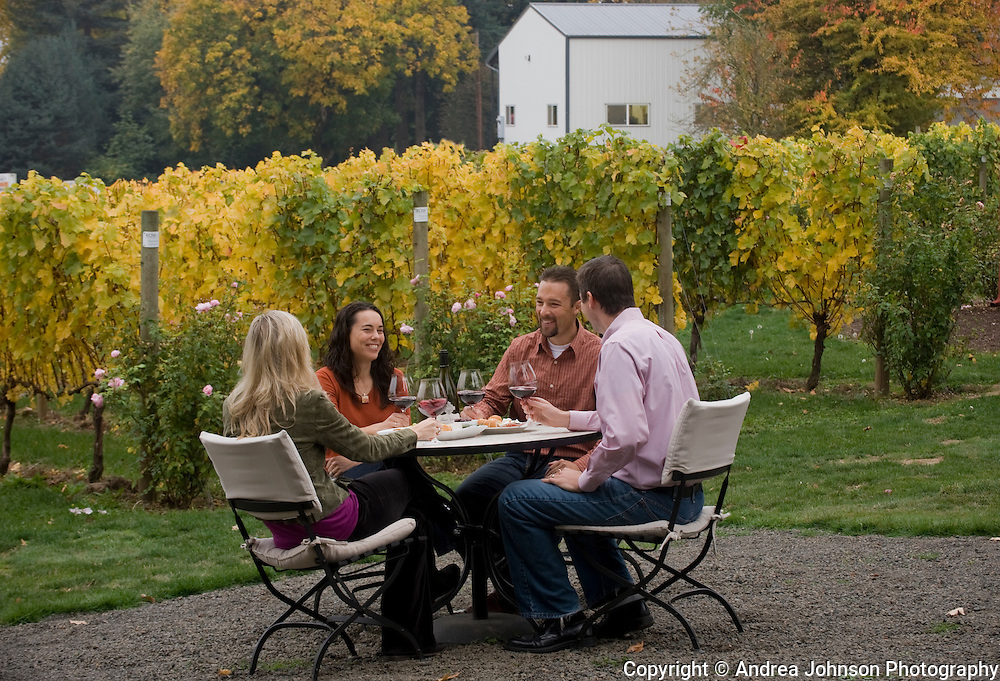 Couples enjoy a fall picnic of pinot noir and cheese at Four Graces Winery, Dundee Hills, Willamette Valley, Oregon