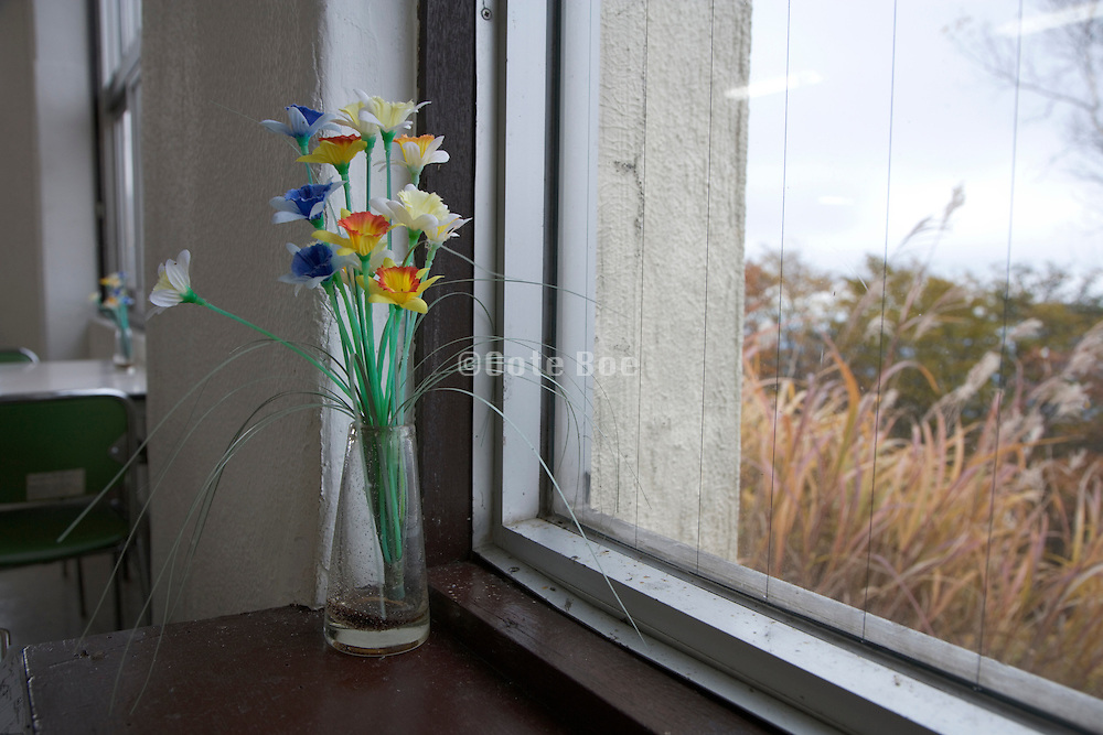 artificial flowers in windowsill
