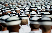 "New midshipmen shortly before taking the Midshipman Oath of Office. Approximately 1,230 young men and women arrived at the U.S. Naval Academy's Alumni Hall, Thursday, July 1, for Induction Day to begin their new lives as ""plebes"" or midshipmen fourth class (freshmen). ""I-Day"" culminates when the members of the Class of 2014 take the oath of office at a ceremony at 6 p.m. in Tecumseh Court, the historic courtyard of the Bancroft Hall dormitory. Over 17,400 young men and women applied to be members of the Naval Academy Class of 2014 - a record for USNA."
