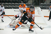 RIT's Jess Paton tries to control a loose puck in the offensive zone during an exhibition game at RIT's Gene Polisseni Center on Monday, September 29, 2014.