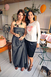 Left to right, host Eva Karayiannis and YASMIN MILLS at the 10th anniversary party of the store Caramel, Ledbury Road, London W11.  The party was held in association with the Naked Heart Foundation - a charity set up by model Natalia Vodianova.