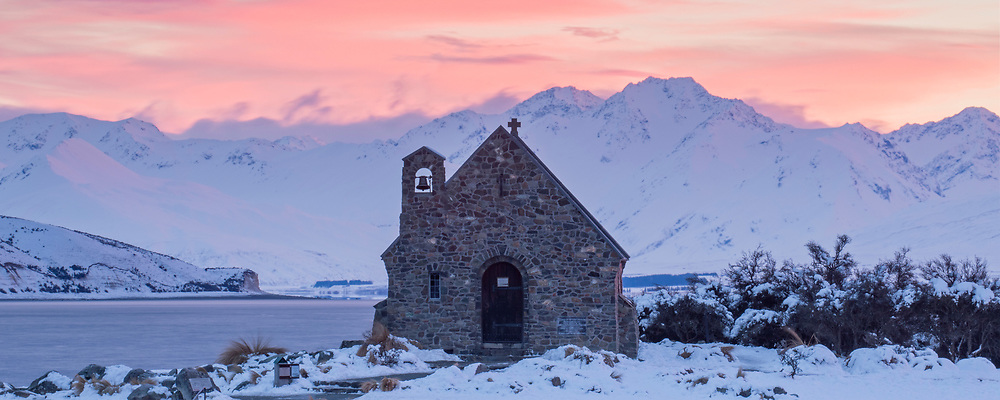 A panoramic of a soft winter sunrise over the Church of the Good Shepherd, at Tekapo, New Zealand.