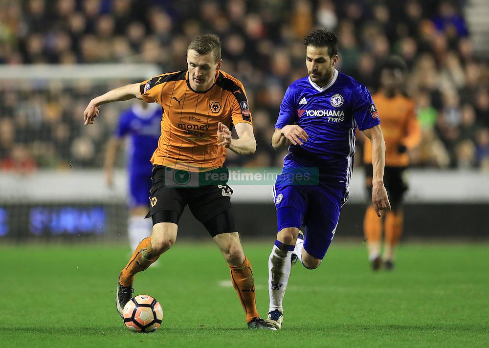 Wolverhampton Wanderers' Jon Dadi Bodvarsson (left) and Chelsea's Cesc Fabregas in action
