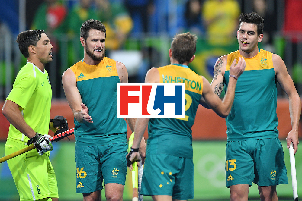 Australia's players celebrate scoring during the mens's field hockey Australia vs Brazil match of the Rio 2016 Olympics Games at the Olympic Hockey Centre in Rio de Janeiro on August, 12 2016. / AFP / Carl DE SOUZA        (Photo credit should read CARL DE SOUZA/AFP/Getty Images)