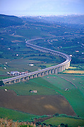 Raised motorway crossing countryside from Segesta, Sicily, Italy
