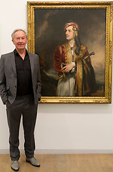 © Licensed to London News Pictures. 15/12/2011. London, UK. Historian and broadcaster, Simon Schama with Thomas Phillips' 'George Gordon Noel Byron, 6th Baron Byron' (1814) which belongs in HM Ambassador's Residence in Athens seen at the Government Art Collection: Selected by Simon Schama: Travelling Light at the Whitechapel Gallery. Photo credit : James Gourley/LNP