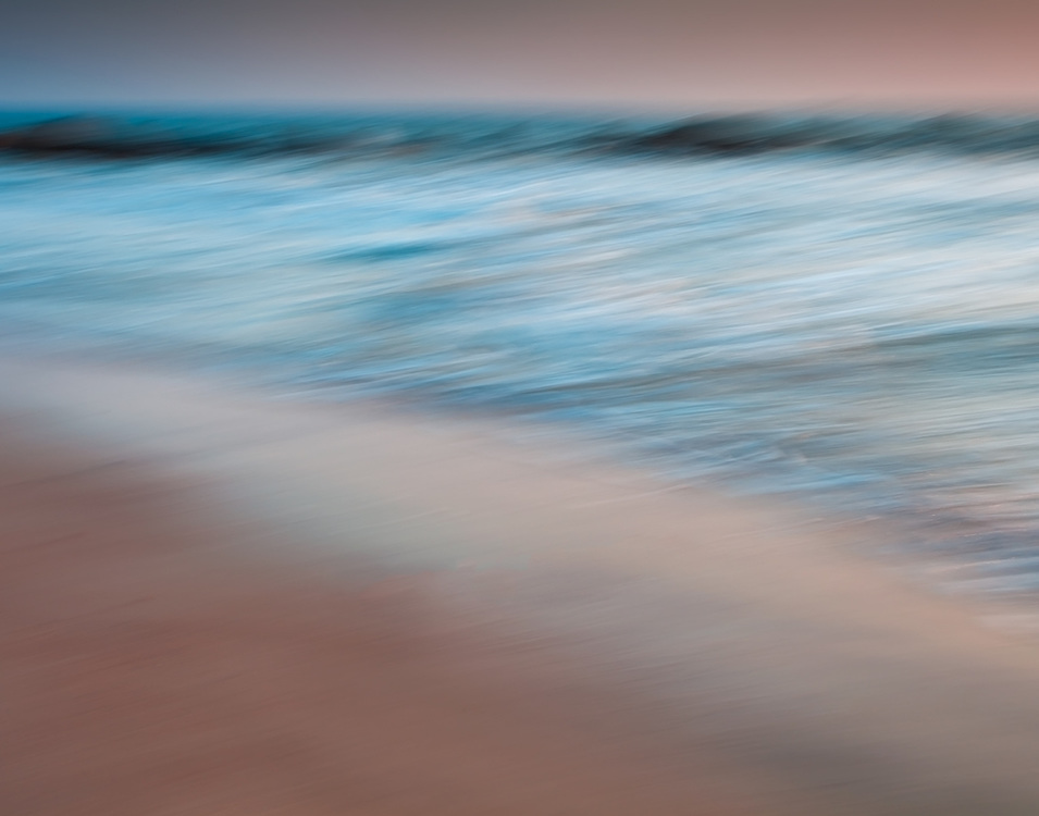 An abstract impressionistic view of the rising tide over the jetty at North Tybee Beach.