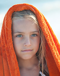 blonde haired green eyed little girl with an orange towel on her head