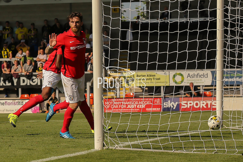 Coventry City midfielder Romain Vincelot puts up his hands as he refuses the protests he touched the ball as Coventry go into the lead 2-1 during the Sky Bet League 1 match between Burton Albion and Coventry City at the Pirelli Stadium, Burton upon Trent, England on 6 September 2015. Photo by Simon Davies.