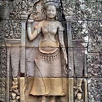Devata Bas-reliefs at Bayon in Angkor Archaeological Park, Cambodia<br /> This graceful female image is a devata. The standing goddess represents the forces of the universe and guardian of the Khmer temple. They are typically depicted as young, beautiful and bare breasted wearing an elaborate headdress and sarong.  Bayon is blessed with over 11,000 sculpted figures measuring nearly 3,300 feet of bas-reliefs. This makes it one of the best ancient art galleries in Cambodia.