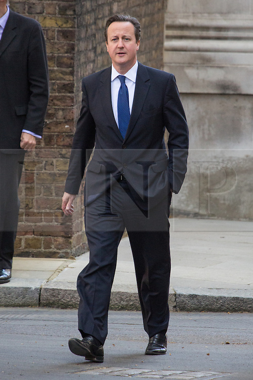 © Licensed to London News Pictures. 09/04/2014. London, UK. David Cameron, the British Prime Minister returns to Downing Street after Prime Ministers Questions today. Photo credit : Vickie Flores/LNP
