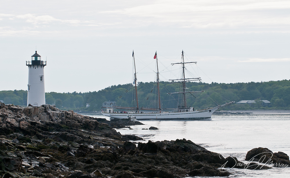 Tall ship Gazela passes by the Portsmouth Light in New Castle, NH as it heads out to sea after attending Sail Portsmouth 2011 in Portsmouth, NH