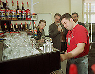 Max Gabriello, foreground, of Andover, Mass., makes some coffee drinks for judges, Sherri Miller, left, Paul Songer, center, and Carlo DiRuocco, far right, during the Torani 5th Annual Barista Cup, Monday, May 3, 1999, in Philadelphia. Gabriello, declared best Barista in the USA, won a trip to Italy. (Photo by William Thomas Cain)