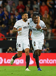 November 3, 2018 - Valencia, Valencia, Spain - Geoffrey Kondobia and Ezequiel Garay of Valencia CF celebrates a goal before revision of VAR during the La Liga match between Valencia CF and Girona FC at Mestala Stadium on November 3, 2018 in Valencia, Spain (Credit Image: © AFP7 via ZUMA Wire)