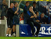 Photo: Daniel Hambury.<br /> Queens Park Rangers v Ipswich. Coca Cola Championship.<br /> 09/08/2005.<br /> QPR's manager Ian Hollaway gives out the orders as his Ipswich counterpart looks on with a worried look on his face.
