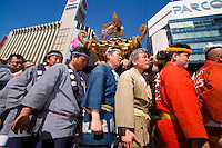 Revellers carry palanquins through the heart of Sapporo to have them blessed by the priests and bring good luck for the coming year.