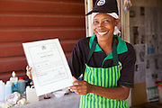 Jovita Masanyika with the certificate she received after registering her business.<br /> <br /> Jovita set up and now runs a soap making business selling a variety of soaps from shampoo to disinfectant.<br /> <br /> She attended MKUBWA enterprise training run by the Tanzania Gatsby Trust in partnership with The Cherie Blair Foundation for Women.