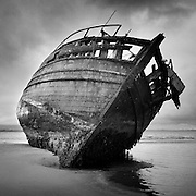 The wreck of the 'Co-Worker' a wooden built relic of a fishing boat that rested on the shore of Ettrick bay, Isle of Bute. The wreck was re-located to Port Bannatyne (not sure if its still there) This was one of my early forays back into (specifically landscape) photographic work back in 2006 and got the fire back in my belly again.