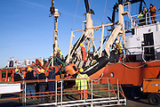 Men loading offshore supply vessel Putford Achilles, Great Yarmouth