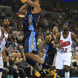 28 January 2009: Denver Nuggets center Nene Hilario (31) shoots during a 94-81 win by the New Orleans Hornets over the Denver Nuggets at the New Orleans Arena in New Orleans, LA. The Hornets wore special throwback uniforms of the former ABA franchise the New Orleans Buccaneers for the game as they honored the Bucs franchise as a part of the NBA's Hardwood Classics series. .