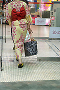 traditional dressed Japanese female going to to do some discount shopping