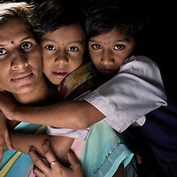 Vidya Ghume, 29 at home with her two daughters Mayuri, 9 and Sakshi, 7. Vidya and Mayuri are HIV positive. Vidya lost her husband to AIDS. She works producing electric fittings at the Save Foundation. ..Photo: Tom Pietrasik.Sangli, Maharashtra. India.August 28th 2008