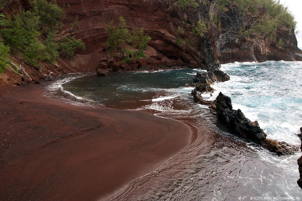 Crashing waves on Red Sand Beach, located in Hana, Maui, Hawaii