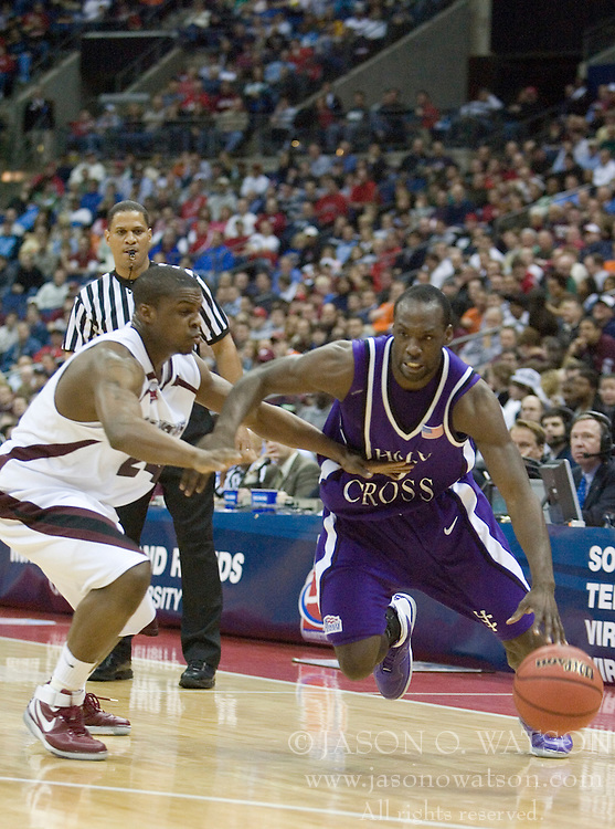 Holy Cross Crusaders guard Keith Simmons (10) dribbles around Southern Illinois Salukis guard Wesley Clemmons (24).  The #4 seed Southern Illinois Salukis defeated the #13 seed Holy Cross Crusaders 61-51  in the first round of the Men's NCAA Tournament in Columbus, OH on March 16, 2007.